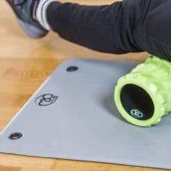 Tapis de gym compact avec oeillets